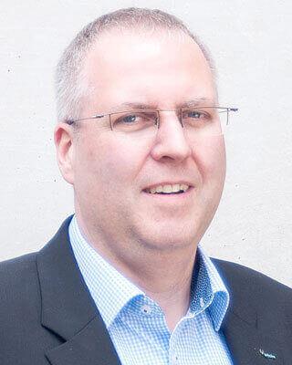 Dr. Stefan Köhler man glasses suit